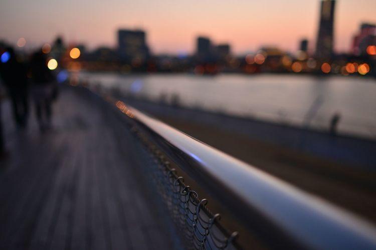 Close-Up Of Fence Railing Against Defocused Background