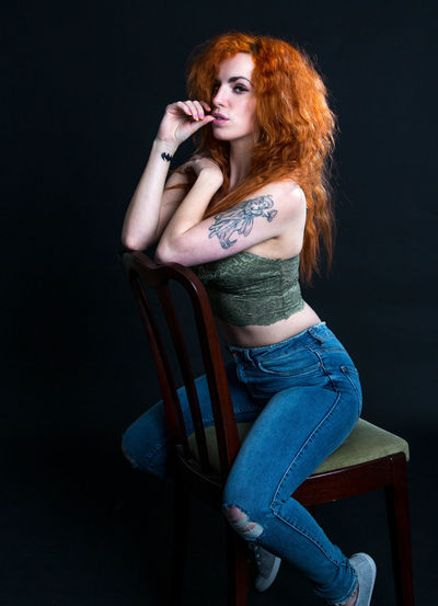 Striking Looking At Camera Long Hair Femininity Indoors  One Person Young Women Portrait Poise , Eyes Watching You Casual Clothing Tattoo Confidence! Bueatiful Womens Portraiture Individuality Haircolor Thoughtful Serious