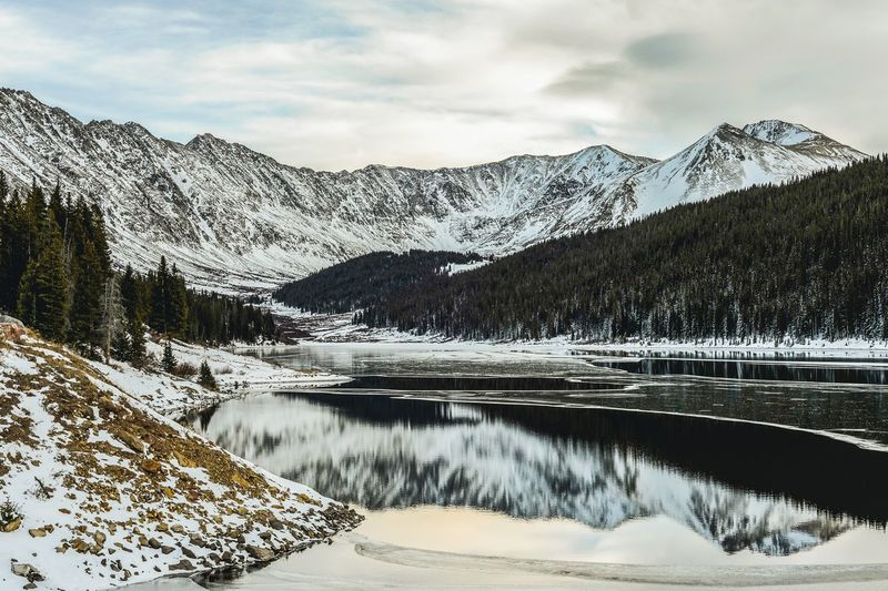 Rocky Mountains Rocky Mountains USA Colorado Mountain Winter Snow Cold Temperature Water Scenics - Nature Sky Beauty In Nature Nature Lake Mountain Range Tranquil Scene Tree Tranquility Non-urban Scene Outdoors No People Day Snowcapped Mountain