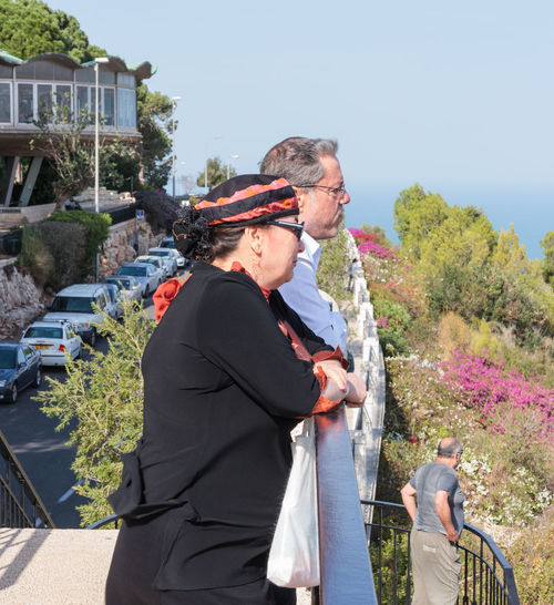 Haifa, Israel, November 19, 2016: Mature couple standing on the terrace and looking dreamily into the distance in Haifa, Israel Adult Adults Only Aged Balcony Couples Day Elderly Happiness Husband Love Married Mature Men Old Outdoor Outdoors People Senior Sky Standing Terrace Together Two Wife Women