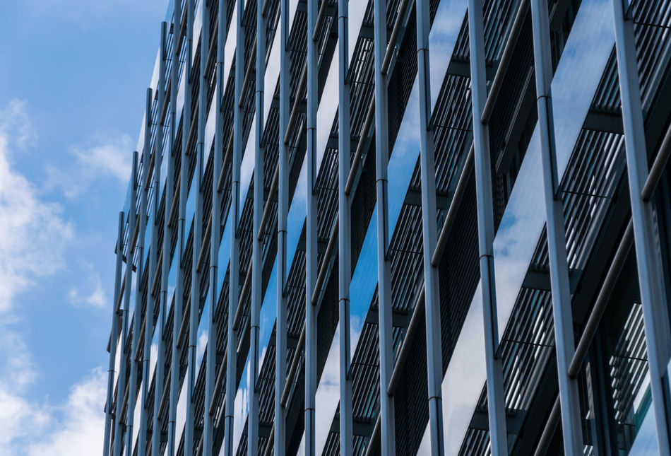 Architectural Feature Architecture Blue Building Building Exterior Built Structure City City Life Cloud Cloud - Sky Fenster Low Angle View Low Angle View Modern No People Office Building Reflection Reflection_collection Repetition Sky Skyscraper Tall - High The Architect - 2016 EyeEm Awards Windows