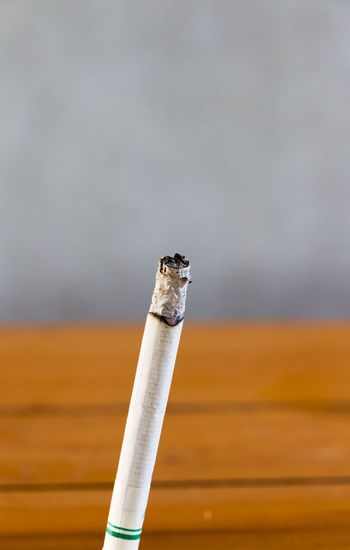 Close-Up Of Lit Cigarette Outdoors