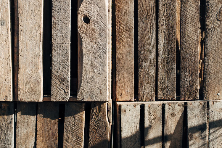 TEXTURES Full Frame Pattern Backgrounds Sunlight No People Day Textured  Wood - Material Shadow Close-up Fence Wall - Building Feature Side By Side Brown Built Structure Architecture Outdoors Barrier Boundary Nature