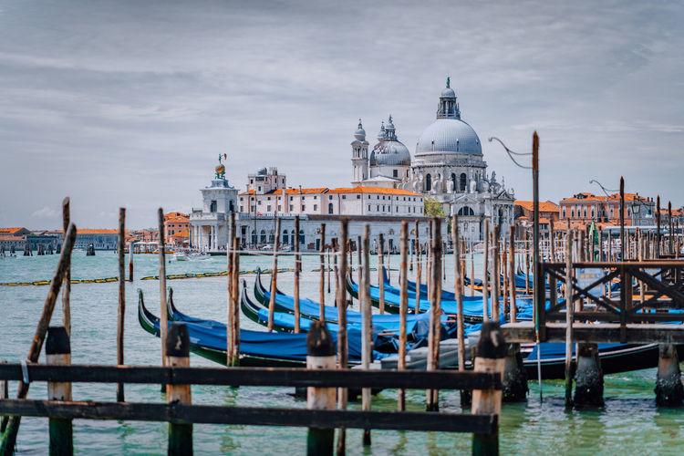 Boats moored in canal against santa maria della salute