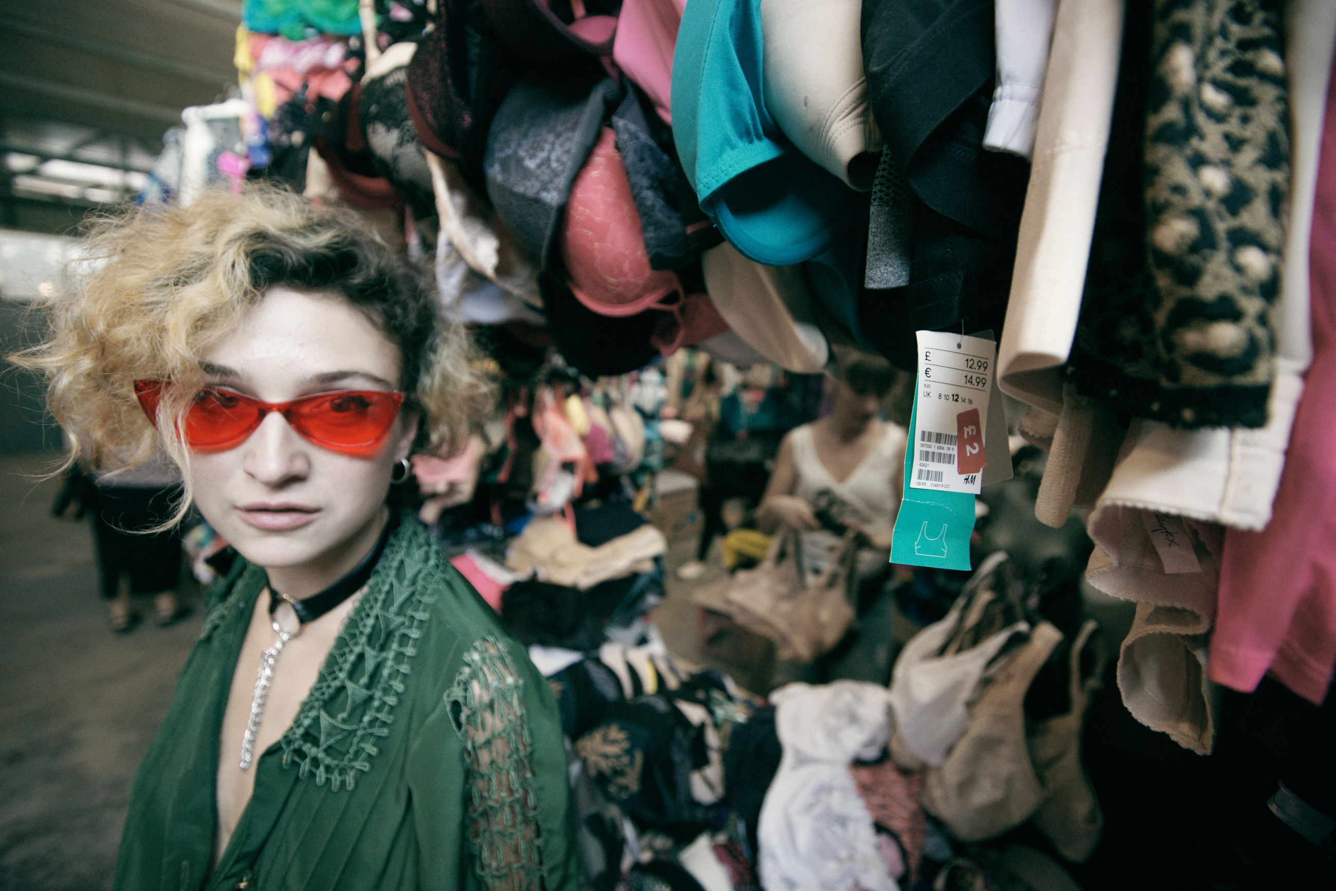 fashion, real people, glasses, retail, women, portrait, sunglasses, people, indoors, group of people, lifestyles, for sale, incidental people, human representation, clothing, choice, mannequin, variation, adult, focus on foreground, retail display