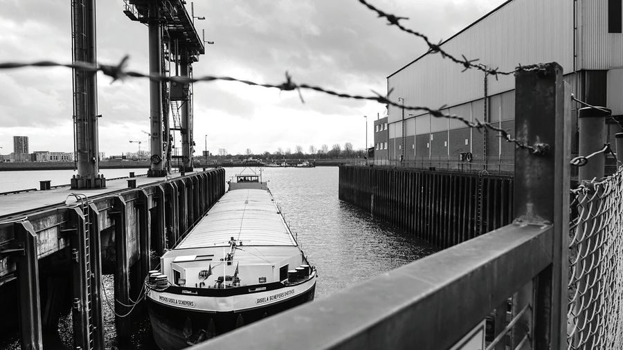 Hanging Out Taking Photos Blackandwhite Streetphotography Urban Capturing Freedom Ship Port River Industrial Fence Barbwire Clouds B&w Street Photography Eye4black&white  Streetphoto_bw Sony taken with Sony Nex6 in Bremen Up Close Street Photography Found On The Roll