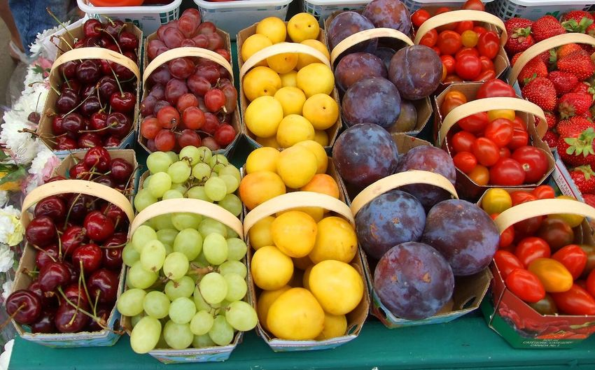 Mixed organic fruits for sale at the farmers market Cherries Farmers Market Apple - Fruit Choice Day Food Food And Drink For Sale Freshness Fruit Grape Grapes Healthy Eating Healthy Fruits Market Multi Colored No People Organic Outdoors Purple Plums Retail  Strawberries Variation Variety Of Fruit Yellow Plums
