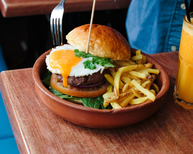 not healthy eating Burger Egg Yolk Burger Close-up Day Egg Food Food And Drink French Fries Freshness Hamburger Indoors  No People Plate Ready-to-eat Serving Size Table Unhealthy Eating