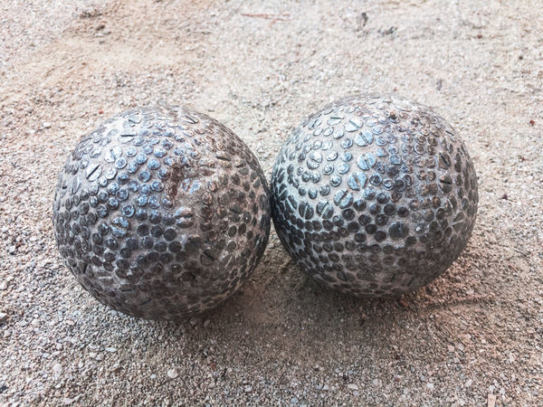Old traditional bocce balls on ground Ball Balls Bocce Boccia Bowl Close-up Court Day Game Goal Ground Leisure Activity Mediterranean  No People Old Outdoors Park Round Skill  Sport Traditional