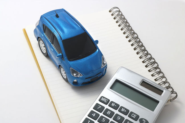 Automobile Buy Calculater Calculator Car Car Insurance Cashmoney  Close-up Copy Space Day Drive High Angle View Indoors  Loan  Model Money No People Rental Car Ride Still Life Studio Shot Technology Transportation Vehicle White Background