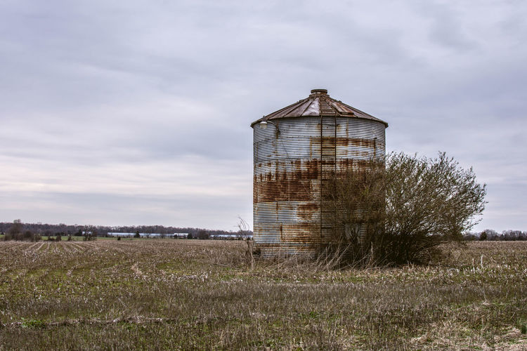 Abandoned structure on field against sky