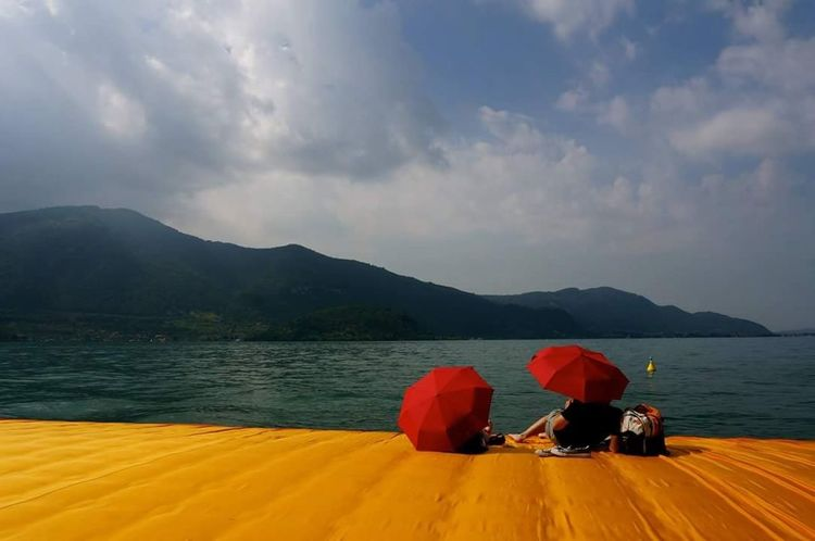 The Floating Piers By Christo The Floating Piers Christo And The Floating Piers Orange Color Iseolake Iseo Lake Lake View Italy Golden Moments 43 43 Golden Moments Art Meets Reality ArtWork Colors Of Life Colour Of Life Two Is Better Than One Paint The Town Yellow