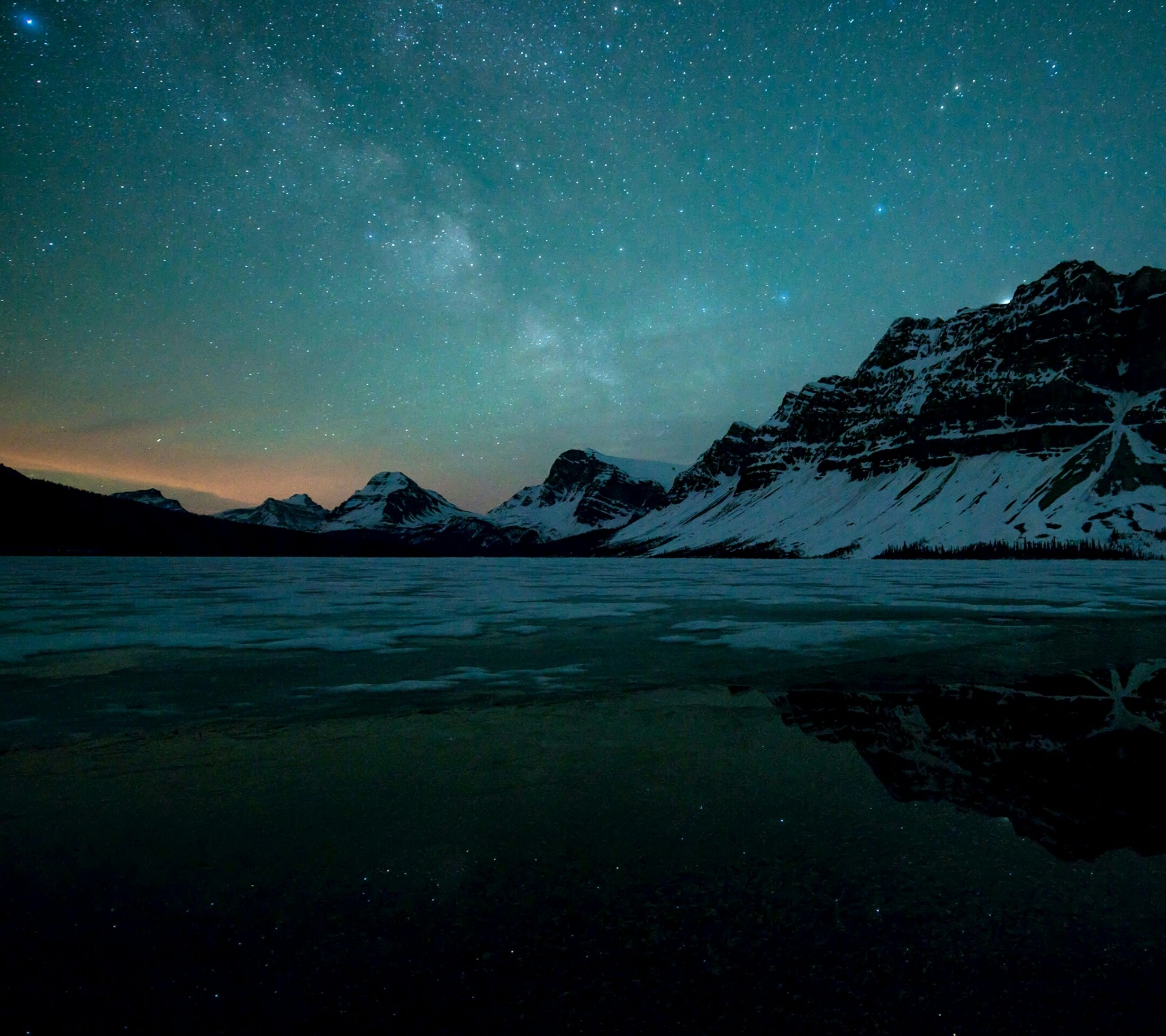 tranquil scene, scenics, night, tranquility, beauty in nature, mountain, star - space, water, nature, mountain range, sky, star field, idyllic, astronomy, snow, lake, majestic, winter, blue, cold temperature