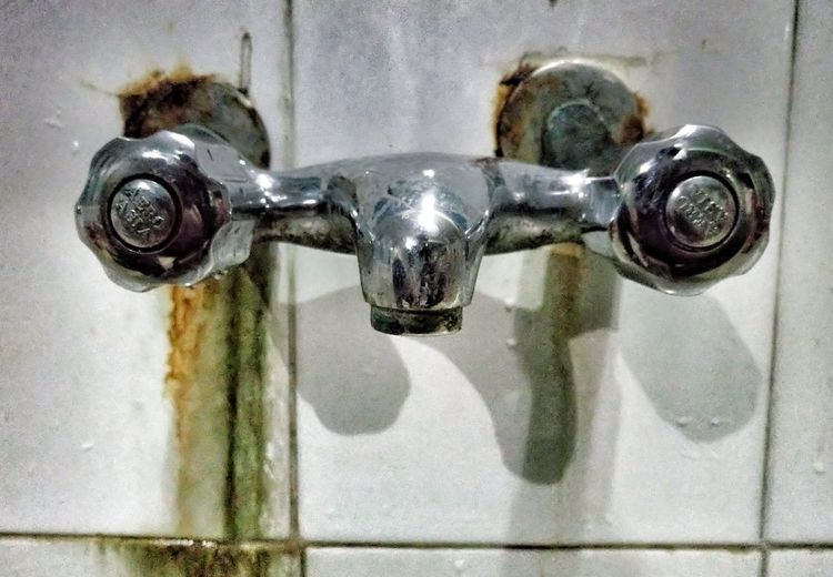 Close-up of faucet in water