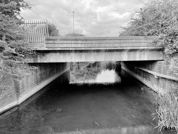 Bridge over canal against sky