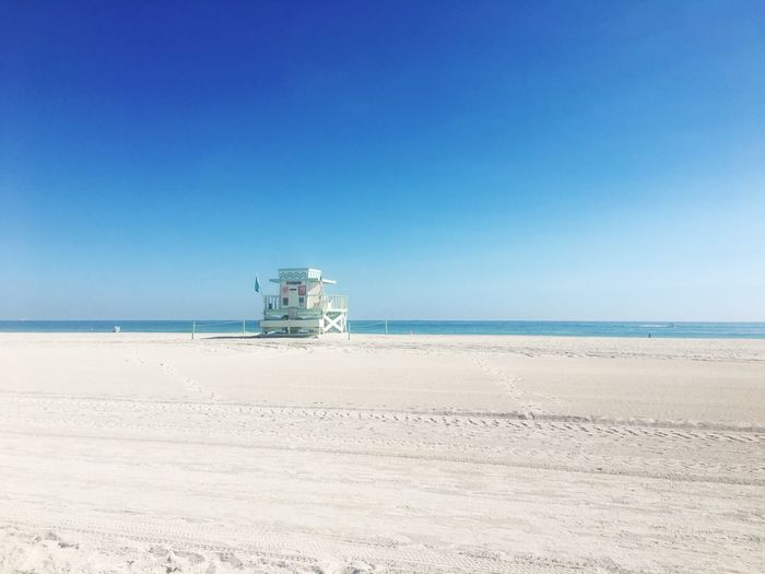 Sea Blue Horizon Over Water Beach Nature Clear Sky Water Sand Tranquility Sky Day No People Beauty In Nature Outdoors Architecture