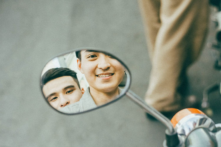 Portrait of a smiling young man with reflection
