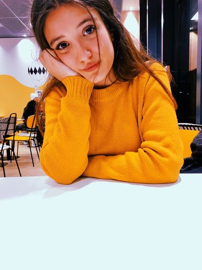 Mcdonalds Yellow One Person Young Women Women Sweater Young Adult Portrait Sitting Looking At Camera Clothing Winter Lifestyles Real People Indoors  Waist Up Beautiful Woman Casual Clothing Leisure Activity Front View Warm Clothing Adult