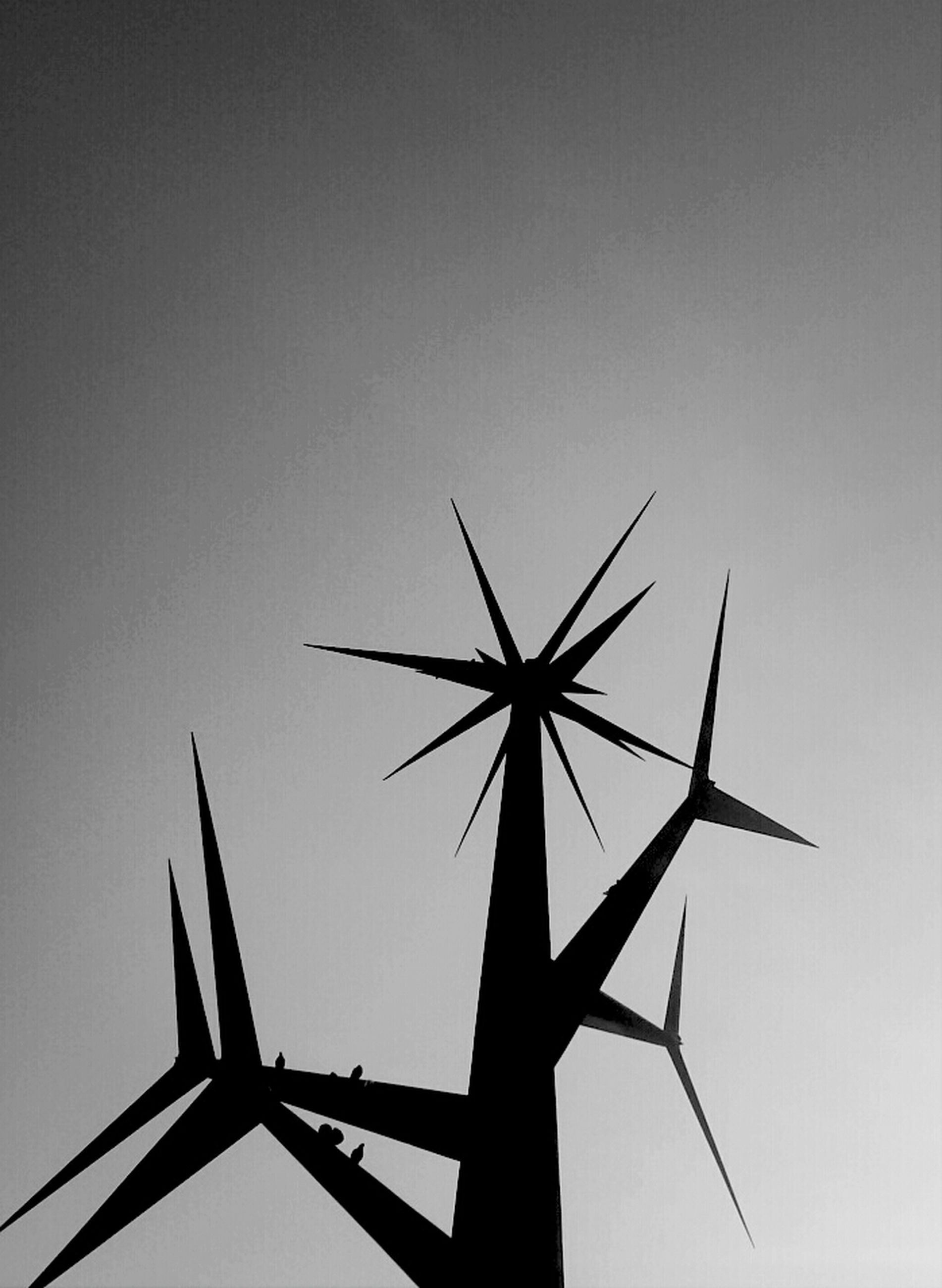 low angle view, clear sky, silhouette, fuel and power generation, alternative energy, environmental conservation, wind power, copy space, sky, technology, renewable energy, wind turbine, windmill, no people, outdoors, day, close-up, part of, traditional windmill, nature