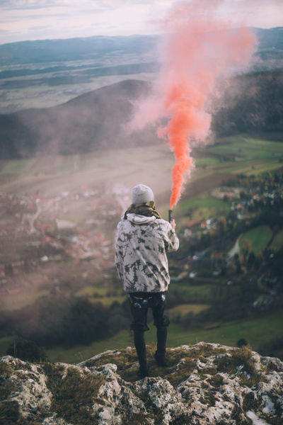 Adventure Beauty In Nature Day Full Length Landscape Leisure Activity Men Mountain Nature One Person Outdoors People Real People Rear View Sky Smoke - Physical Structure Standing Warm Clothing Water