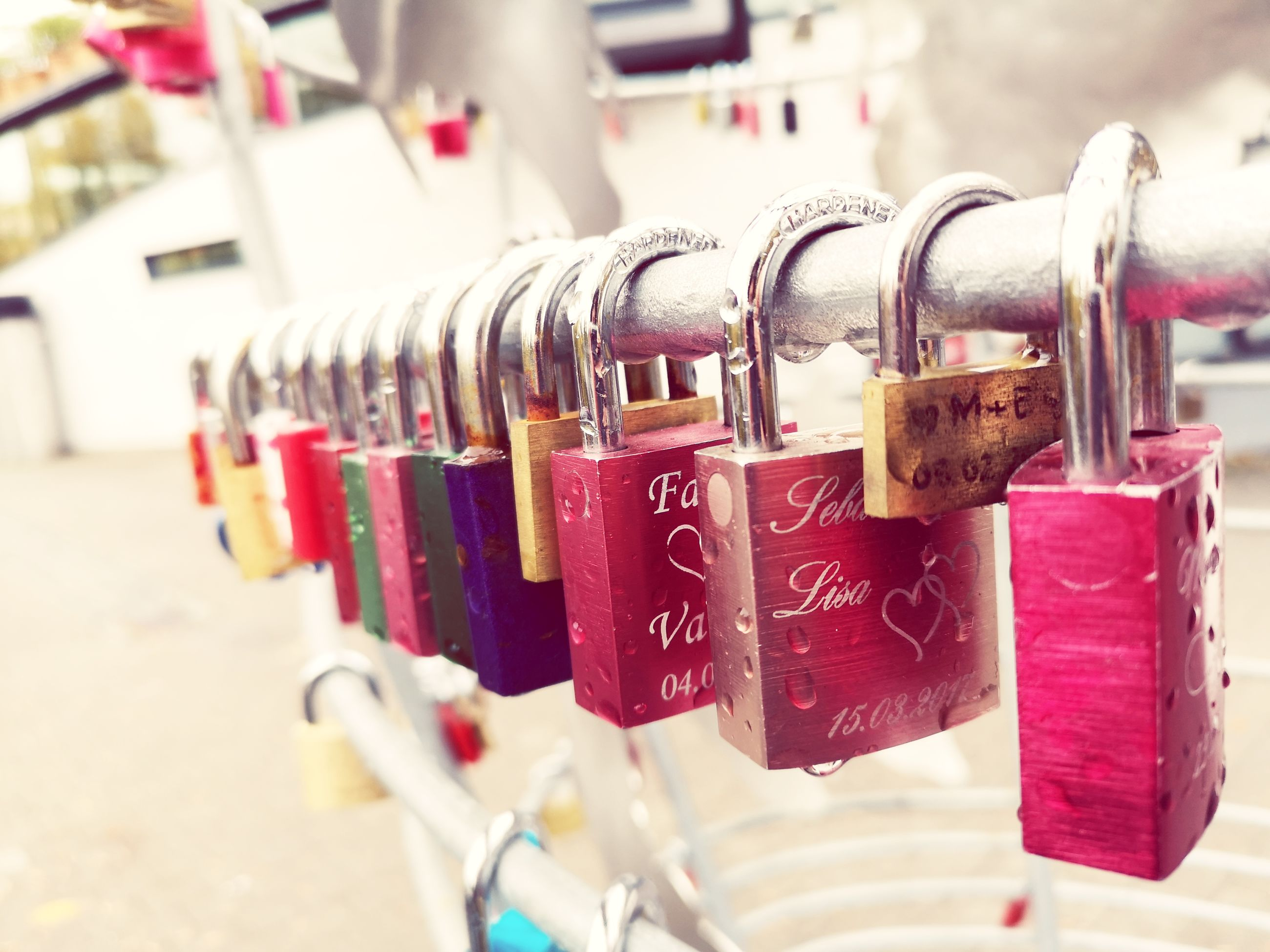 lock, padlock, security, safety, hanging, protection, love, close-up, metal, focus on foreground, love lock, large group of objects, positive emotion, no people, in a row, multi colored, variation, day, railing, red, outdoors
