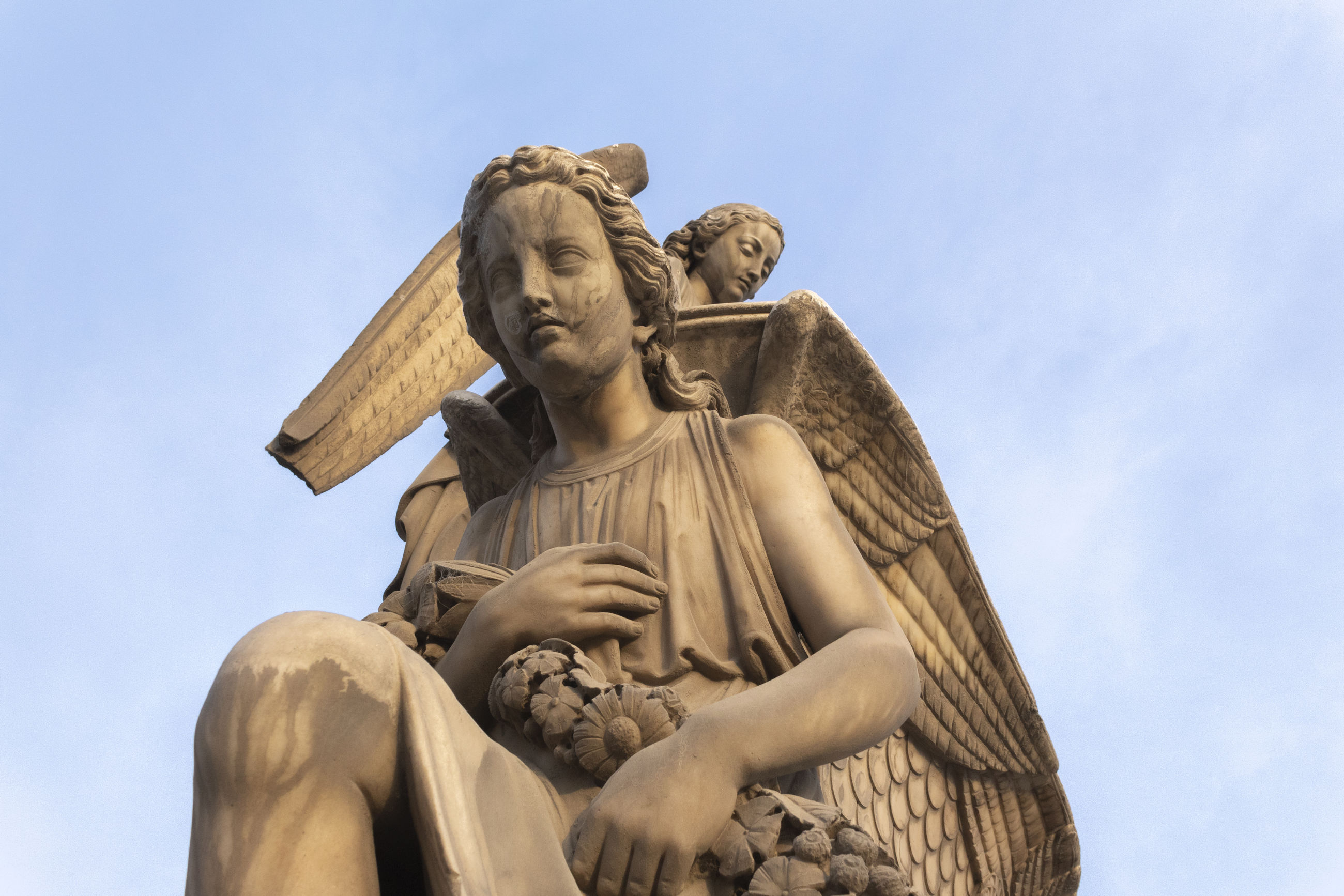 sculpture, statue, representation, low angle view, art and craft, human representation, sky, male likeness, creativity, day, nature, no people, architecture, religion, craft, blue, outdoors, female likeness, belief, angel
