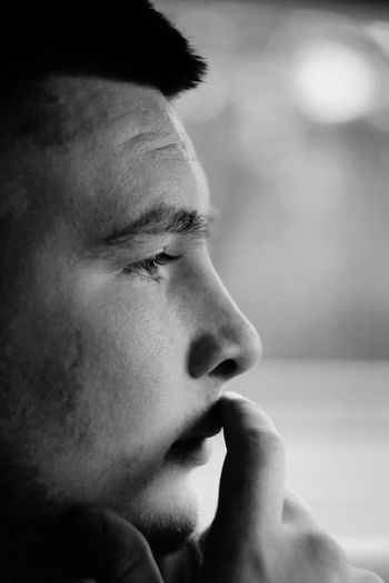 Close-up of thoughtful man looking away