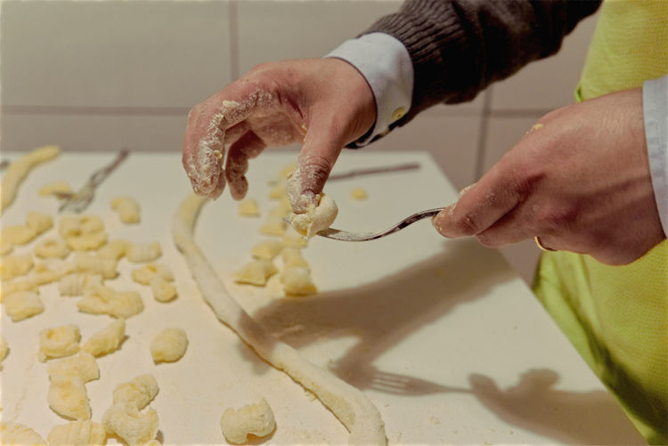 Human Hand Preparation  One Person Hand Indoors  Food Real People Preparing Food Food And Drink Kitchen Freshness Making Occupation Dough Chef Kneading Gnocchi Homemade Italian Food Italian Kitchen Pasta Fresh On Eyeem  Italian Fingers Table