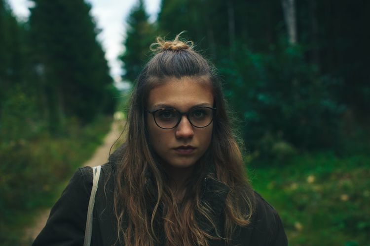Exploring the forest Young Adult Focus On Foreground Young Women Real People One Person Front View Tree Outdoors Beautiful Woman Eyeglasses  Nature Day Standing Lifestyles Portrait Close-up Mood Hair Glasses Nature Photography Hairstyle Glasses Portrait Photography Forest Adventure