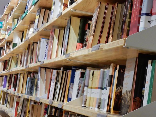 Abundance Arrangement Book Bookshelf Choice Collection Copertine Education Feltrinelli In A Row Indoors  Large Group Of Objects Learning Library Libreria Literature No People Order Publication Scaffali Scrittori Shelf Still Life