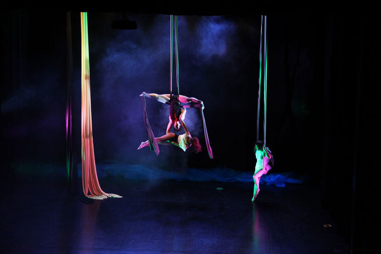 Acrobacy Artist Arts Culture And Entertainment Colors Creation Glowing Show Theater