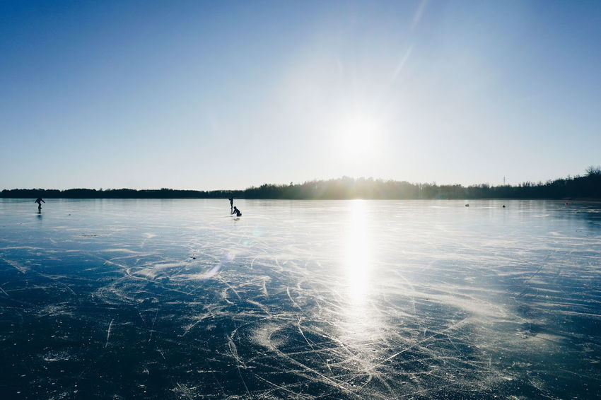 ice skating Blue Water Reflection Outdoors Lake Sport Silhouette Sky Tranquility Nature Clear Sky People Scenics Wintertime Cold Temperature Ice Skating Togetherness Healthy Lifestyle Winter Vacations Beauty In Nature Leisure Activity Adventure Ice Skate Cold Days The Great Outdoors - 2017 EyeEm Awards