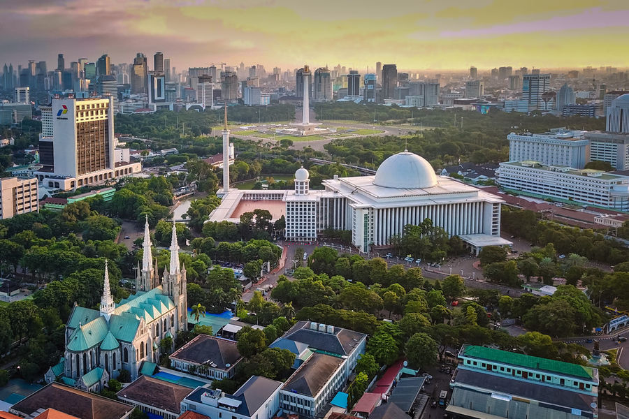 Big mosque and cathedral living in harmony, side by side in Jakarta City Cityscape Building Sky Tree High Angle View Travel Destinations No People Outdoors Jakarta Istiqlal Mosque Cathedral Mosque And Church Drone Shots Drone Photography Aerial View Living In Harmony Moslem Islam Catholic EyeEmNewHere