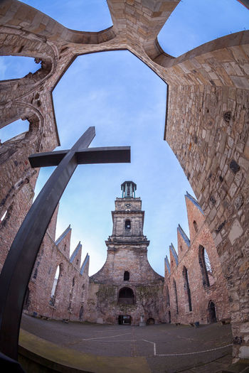 Architecture Church Church Tower Churches City Cloud - Sky Cross Day Fisheye Historical Monument No People Outdoors Roof Sky Sky And Clouds The Architect - 2017 EyeEm Awards The Architect - 2017 EyeEm Awards