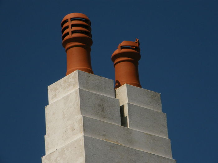 Architecture Building Exterior Built Structure Chimney Pots Clear Sky Day Low Angle View No People Outdoors Sky Minimalist Architecture