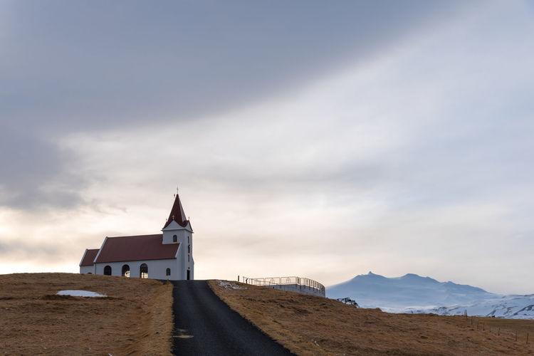 Church by building against sky