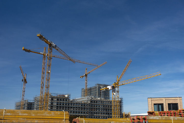 Construction site with tower crane for lifting building materials