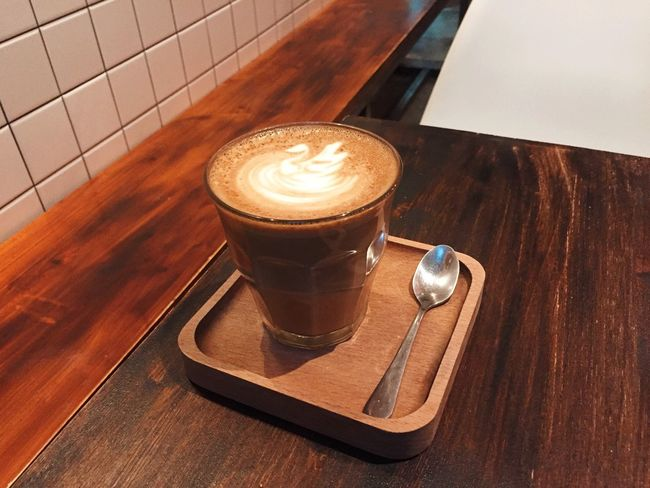 Coffee - Drink Coffee Cup Refreshment Frothy Drink Cappuccino Table Drink Froth Art Food And Drink Latte Still Life Indoors  High Angle View Wood - Material Saucer No People Cafe Freshness Close-up Day
