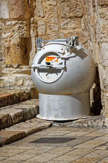 Machinery by stone wall