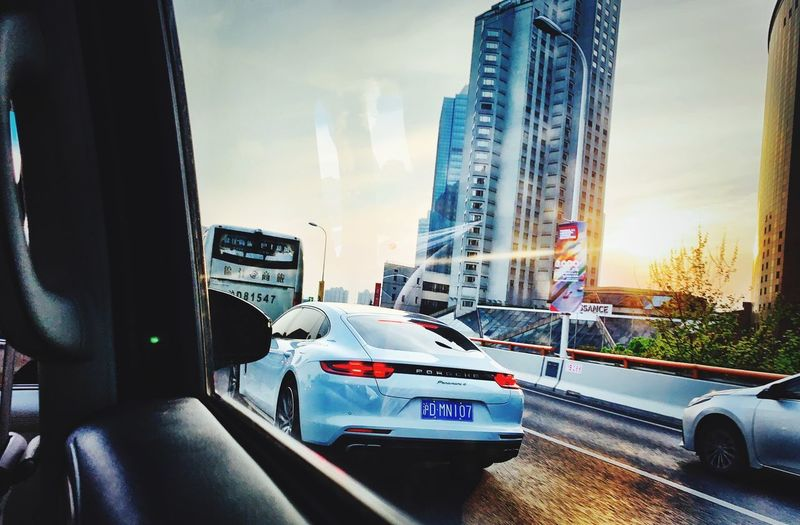 Car Transportation Mode Of Transportation City Motor Vehicle Land Vehicle Architecture Street Building Exterior Travel Nature Built Structure No People Transparent Glass - Material Cloud - Sky Sunset Sky Road Tower