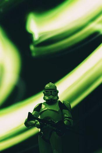 Close-up of illuminated green light bulb