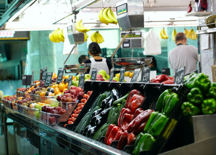 Vegetables and fruits for sale at market stall