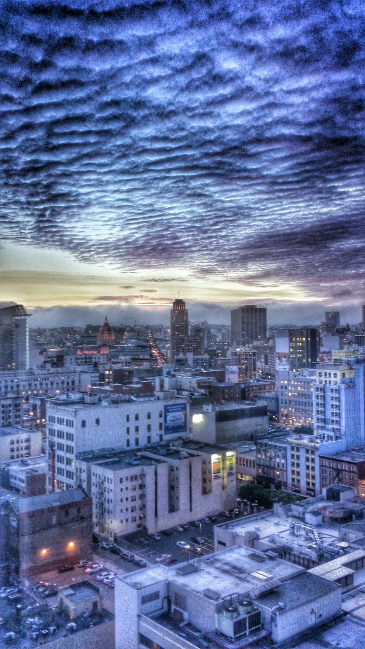 cityscape, architecture, city, building exterior, built structure, illuminated, no people, cloud - sky, sky, outdoors, snow, winter, sunset, night, nature, skyscraper