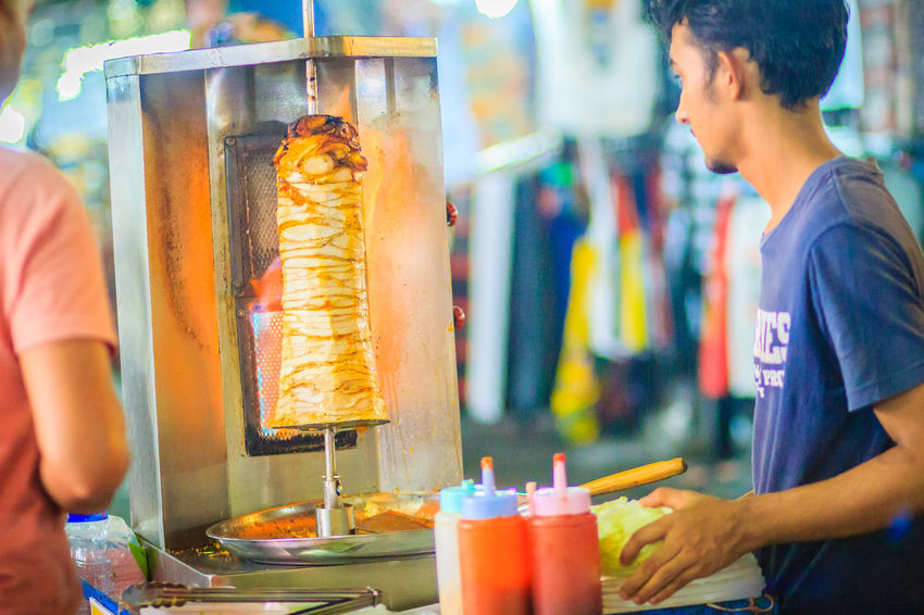 Bangkok, Thailand - March 2, 2017: Street vendor is selling grilled kebab, the popular street foods at Khao San Road night market, Bangkok, Thailand. Grilling Kebab Meat Kebabs Khao San Rd Khao San Road KhaoSan Khaosan Rd. Khaosandroad Tourist Tourist Attraction  Tourists Adult Business Drink Drinking Glass Focus On Foreground Food Food And Drink Freshness Glass Holding Household Equipment Incidental People Indoors  Kebab Kebab Shop Kebabers Khao San Khao San Knok Wua Khao San Rd. Khaosan Road Khaosanroad Lifestyles Men Night Market Night Market In Thailand Night Market, People Real People Refreshment Standing Tourist Destination Two People