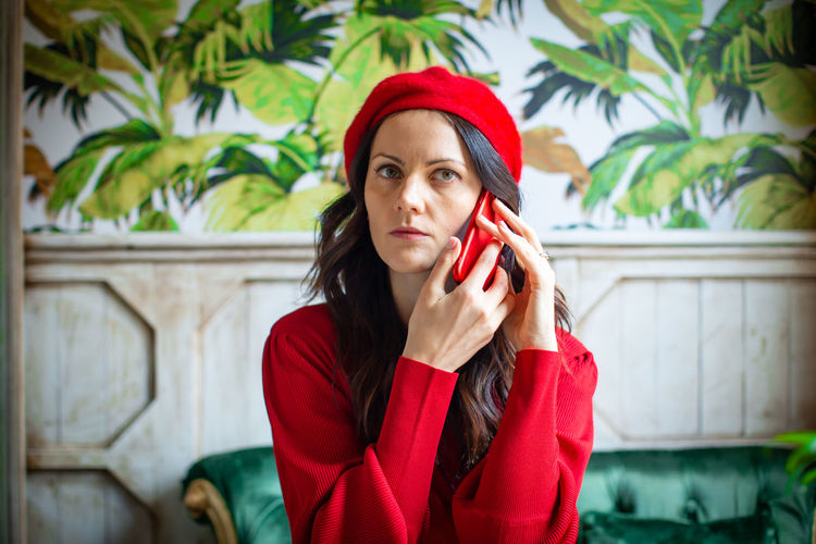 Young Adult One Person Red Clothing Young Women Front View Lifestyles Hat Portrait Real People Casual Clothing Women Beautiful Woman Adult Looking Leisure Activity Holding Looking At Camera Hairstyle Hair Warm Clothing Scarf Telephone Speaking On The Phone