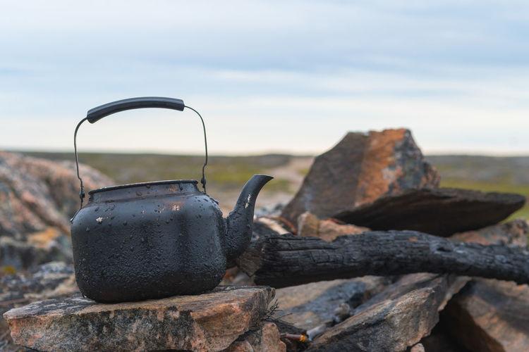 Teapot On Stone Against Sky