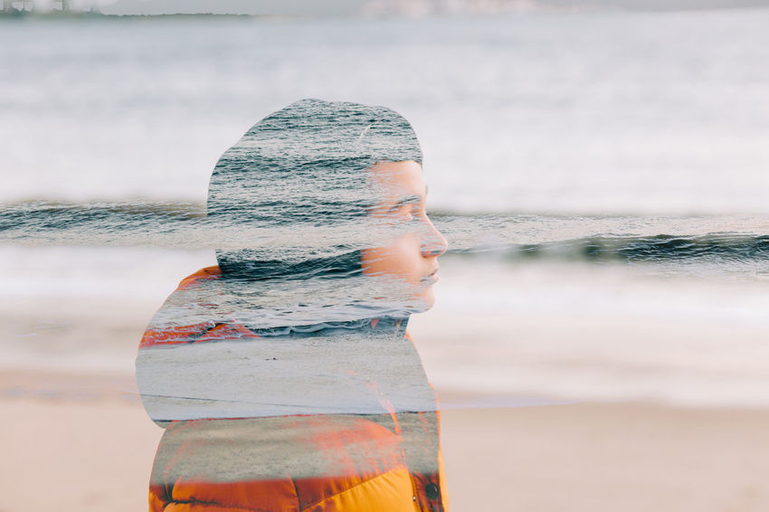 Water One Person Nature Day Real People Leisure Activity Focus On Foreground Lifestyles Motion Outdoors Sea Land Standing Beach Beauty In Nature Double Exposure