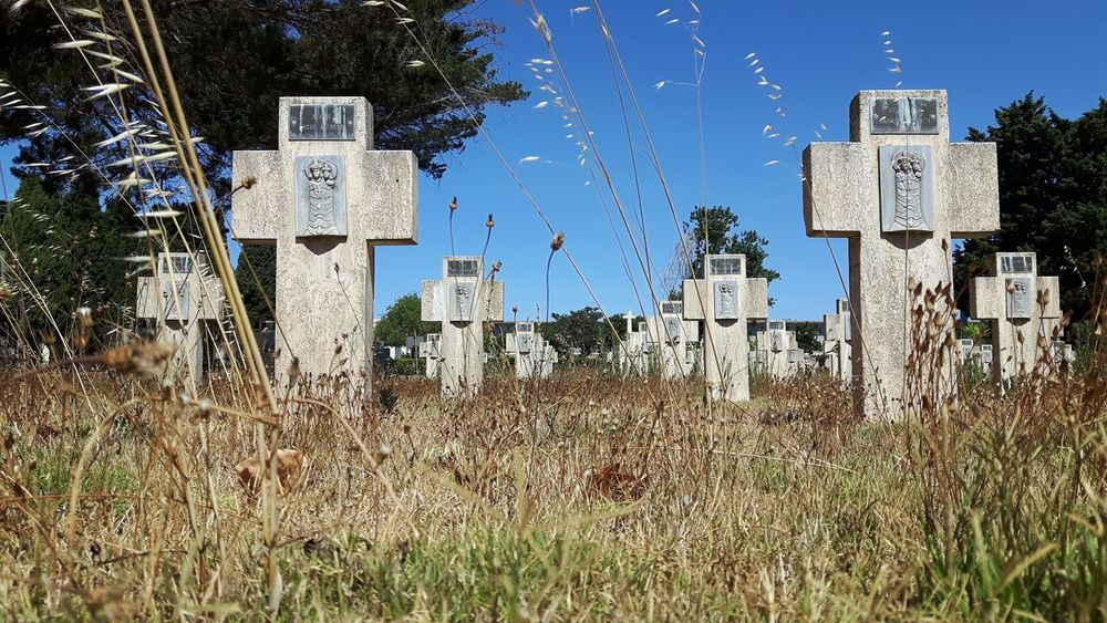 Cemetery in Cagliari, Italy. Cemetery Graveyard Tomb Tombs Tombstone Tombstones Cross Crosses Religion Dead Death End Blue Sky San Michele Cagliari Sardinia Sky Grass Close-up