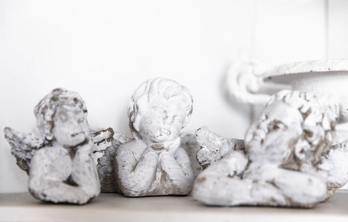 Three angel figurines - Hindeloopen, Friesland, Netherlands Angels Christmas Hope Innocence Old-fashioned Romantic Angel Atmospheric Mood Cherub Christmas Decoration Close-up Decoration Figurine  Home Decor Indoors  No People Putto Religion Sculpture Sculptures Still Life Three Objects Vintage White White Color