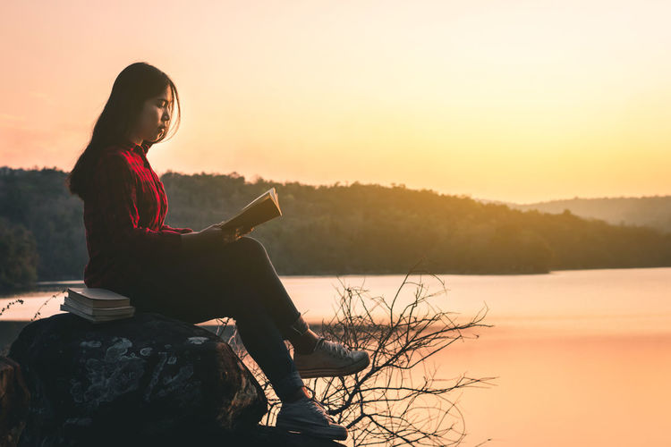 Nature Read Beauty In Nature Book Landscape Lifestyles One Person Outdoors Reading A Book Sky Sunset Water Women